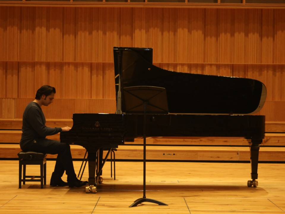 Babak Kazemi is playing piano in a concert in Birmingham